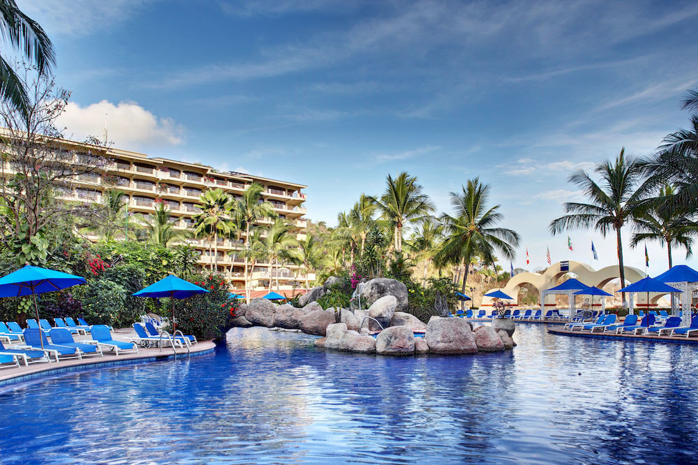 All-inclusive All-Inclusive Resorts Exterior Grounds Historic Hotels Luxury Pool outdoor sky umbrella tree leisure swimming pool Resort scene vacation resort town Sea estate amusement park marina blue bay Lagoon Water park Harbor colorful palm swimming lined day