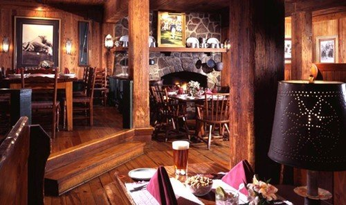 Hotels indoor Living room table floor window chair Fireplace furniture restaurant Bar Dining Winery Boutique wood area decorated dining table dining room