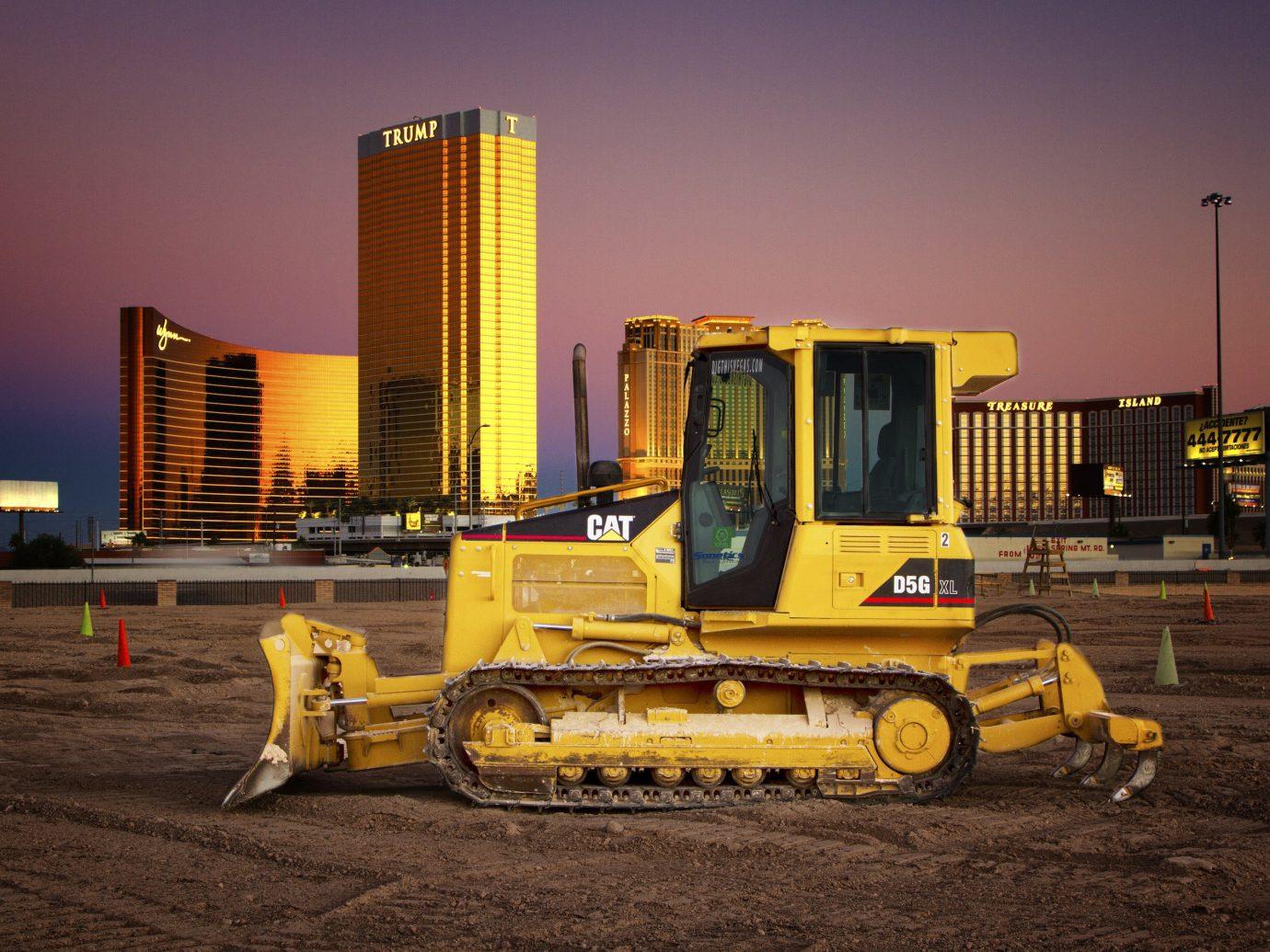 Trip Ideas sky outdoor truck yellow transport vehicle construction equipment asphalt bulldozer power shovel construction equipment