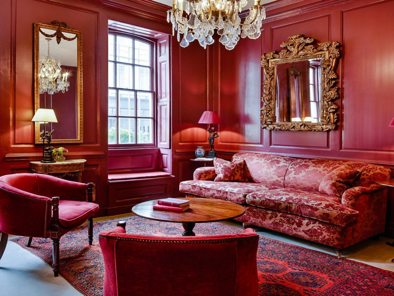 Boutique Hotels London Romantic Hotels indoor floor room Living window red sofa wall living room chair interior design furniture home couch decorated Suite table rug Lobby estate bright colorful colored leather