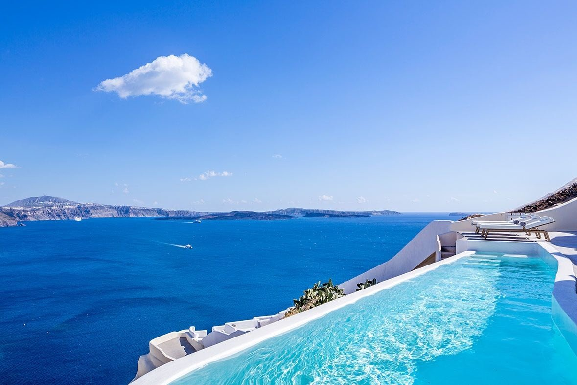 Greece Hotels Luxury Travel Santorini sky water outdoor Sea coastal and oceanic landforms swimming pool Nature Ocean vacation bay Lagoon tourism blue shore day