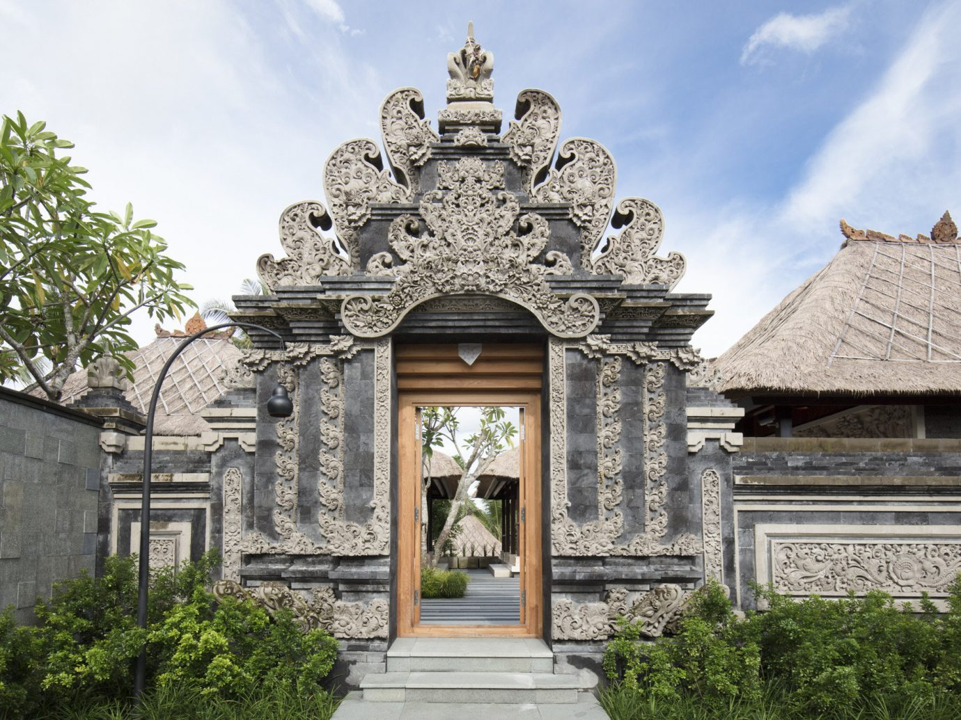 Health + Wellness Hotels historic site ancient history place of worship estate temple building sky facade tree wat palace tourist attraction château mansion monument classical architecture archaeological site symmetry statue hindu temple