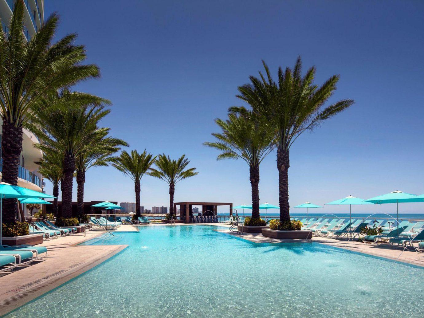 Hotels Secret Getaways Trip Ideas outdoor tree sky palm Beach swimming pool Resort vacation Sea caribbean Ocean arecales estate bay Lagoon Pool marina tropics blue lined shore colorful