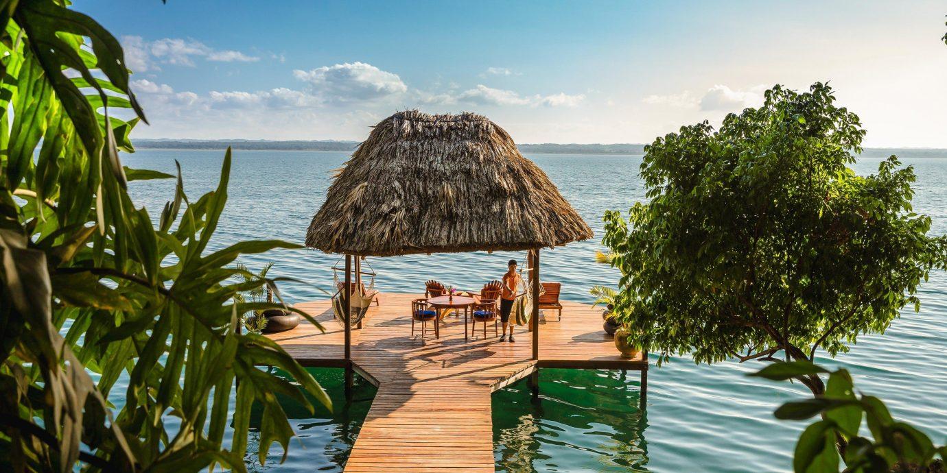 Celebs Hotels Trip Ideas Resort tropics Sea arecales palm tree vacation tree sky Ocean water caribbean real estate leisure tourism Lagoon Island cottage