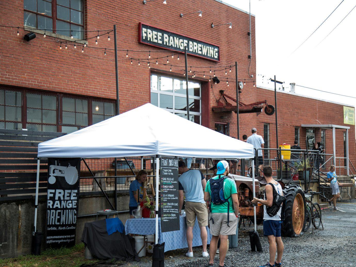 Trip Ideas building outdoor sky public space City street people stall market facade