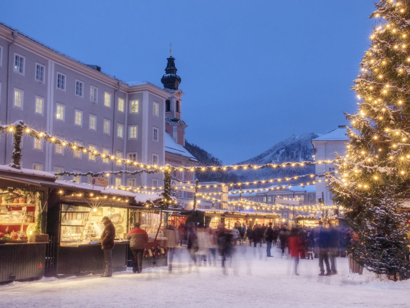 Trip Ideas outdoor sky building Town City Winter plaza human settlement snow cityscape evening Downtown town square
