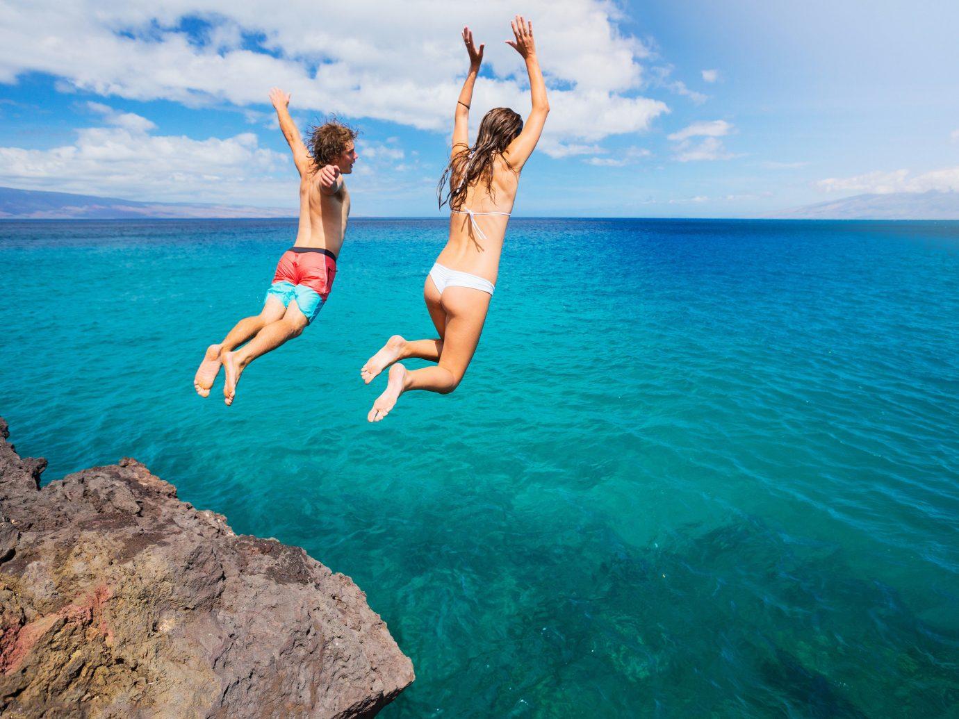 Offbeat water sky outdoor Sea Ocean vacation water sport Beach swimming Coast caribbean Nature cape bay jumping beautiful day