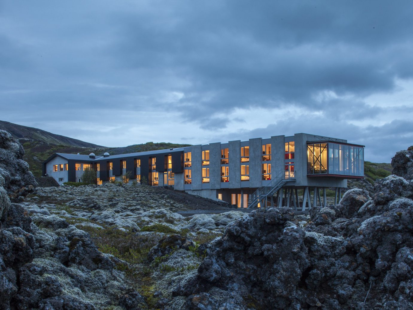 Architecture Boutique calm clouds cloudy contemporary Design dreary Exterior Hotels Iceland isolation lights Luxury majestic Modern Mountains Nature Outdoors private remote rock Rocks Scenic views serene Style + Design Trip Ideas unique view sky train outdoor track transport yellow mountain vehicle rolling stock traveling rail transport bridge railroad engine