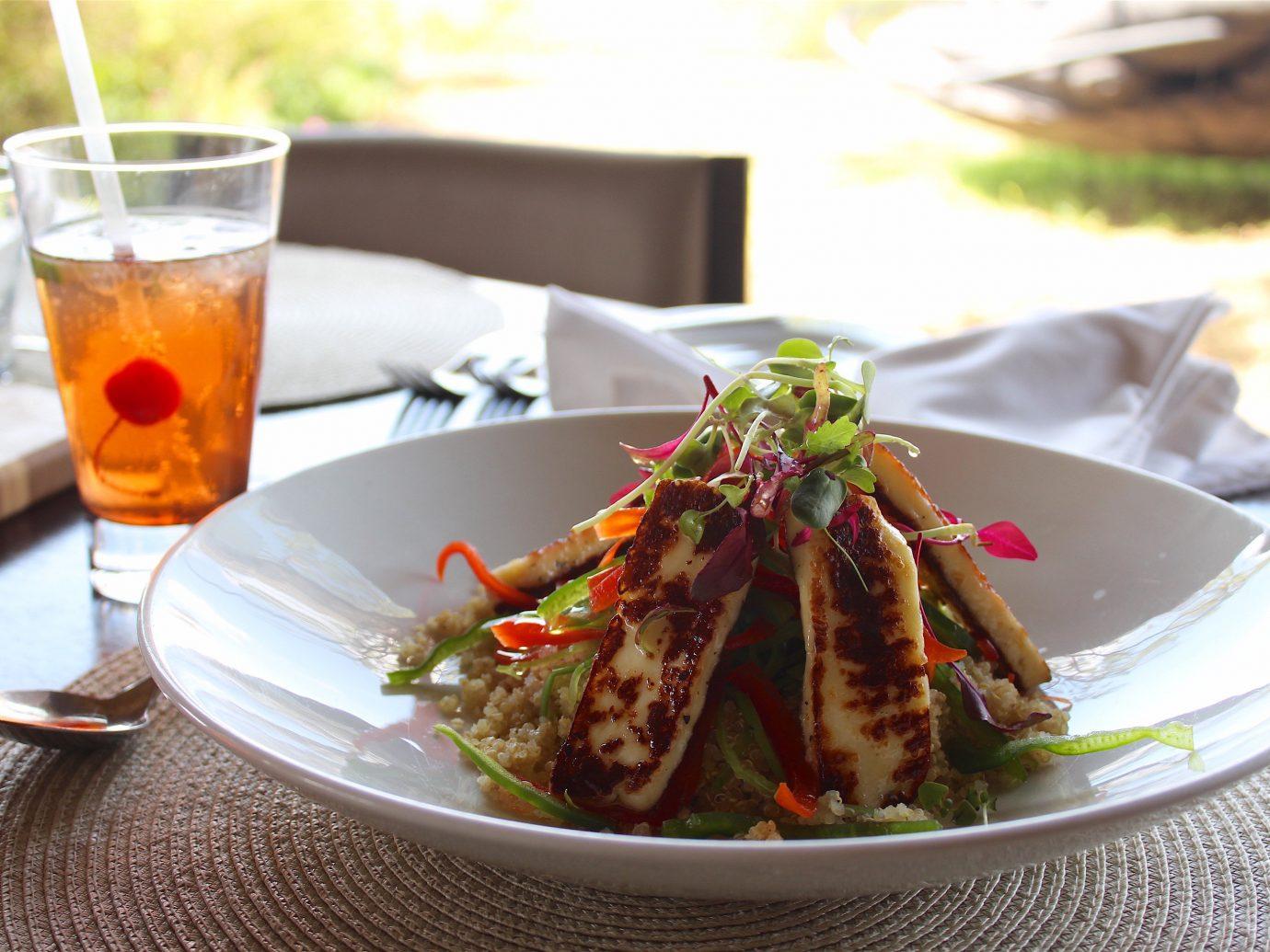 Outdoors + Adventure Safaris Trip Ideas table plate food dish cup arthropod restaurant meal cuisine Seafood Drink produce