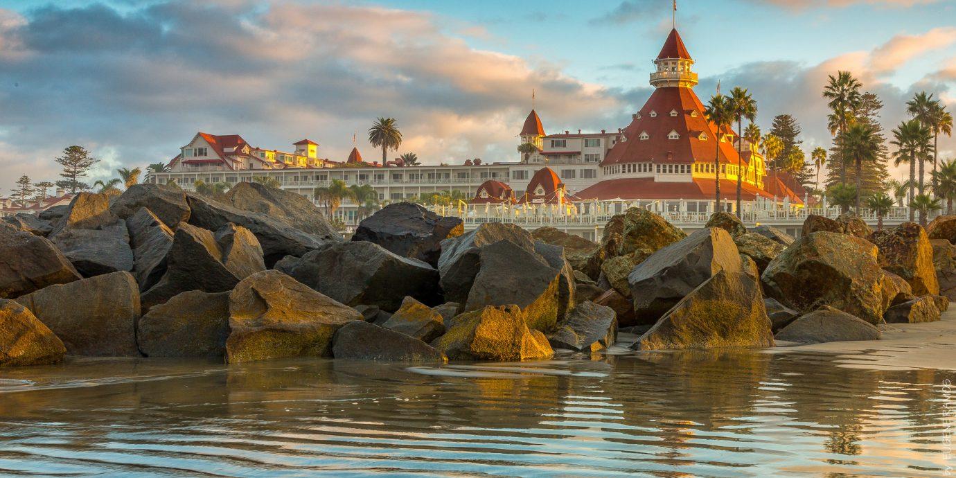 Hotels outdoor reflection landmark Sea Coast morning River evening Ocean rock Nature dusk cityscape temple Sunset stone