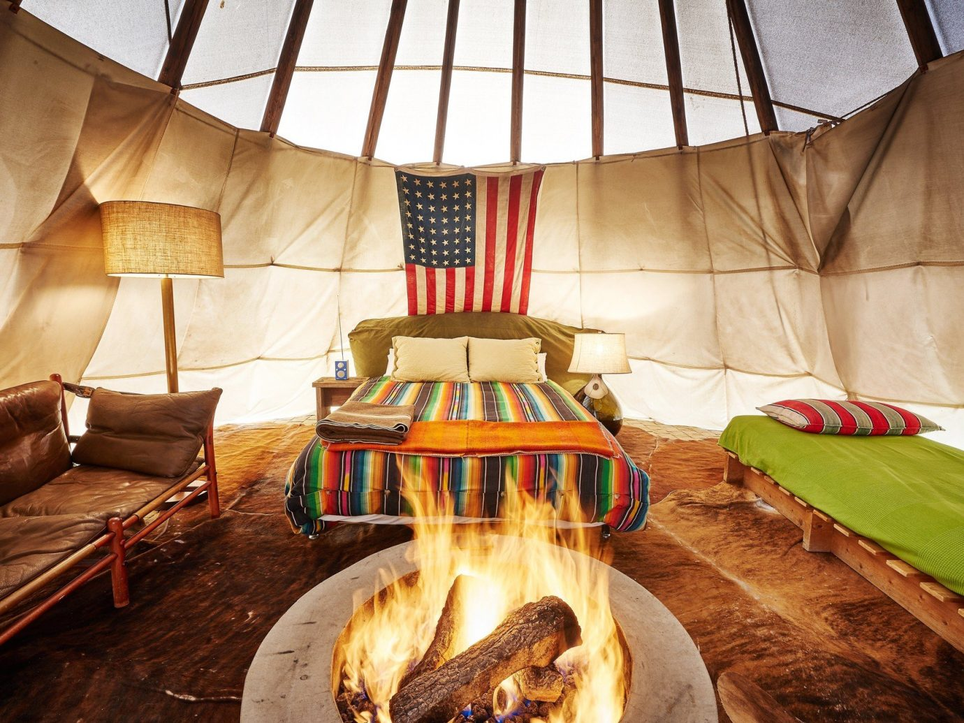 artistic artsy bed Bedroom cozy fire Firepit Fireplace Hip Hotels interior isolation living area quirky remote Solo Travel teepee trendy Trip Ideas indoor decorated bedclothes furniture