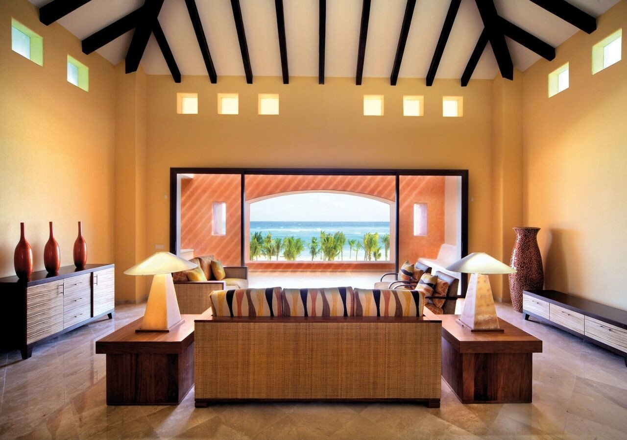 All-Inclusive Resorts Family Travel Hotels indoor floor wall room property ceiling living room interior design estate real estate furniture window table Suite flooring interior designer Lobby daylighting area wood