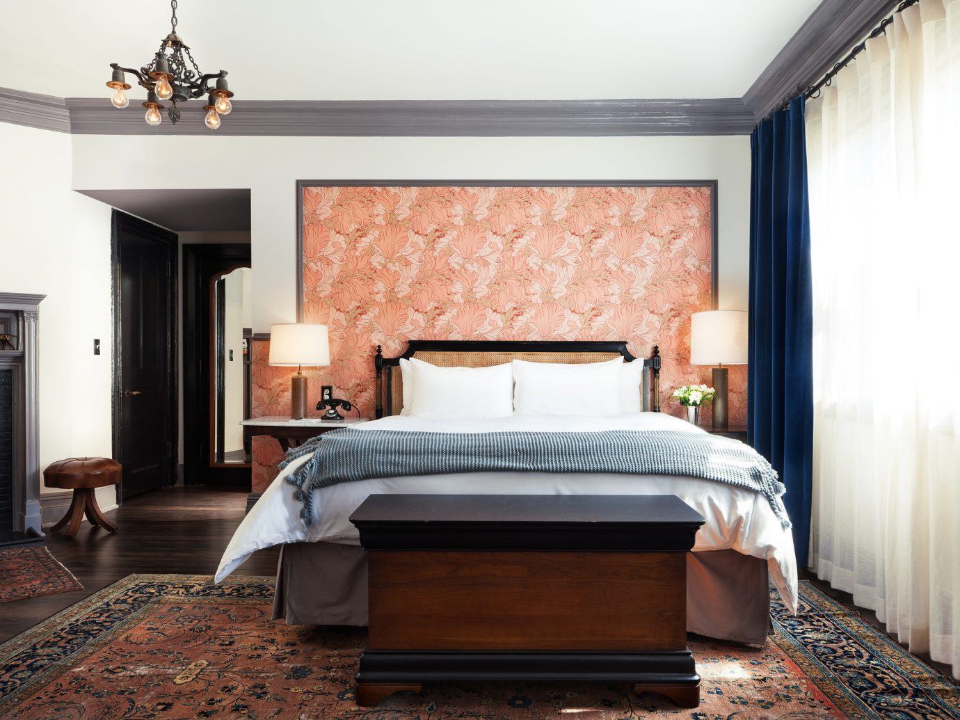 Boutique Hotels Hotels Luxury Travel Romance Romantic Hotels Trip Ideas Winter indoor Living room floor wall sofa Fireplace bed frame Bedroom window interior design ceiling furniture Suite home mattress bed real estate bed sheet window treatment window covering interior designer rug