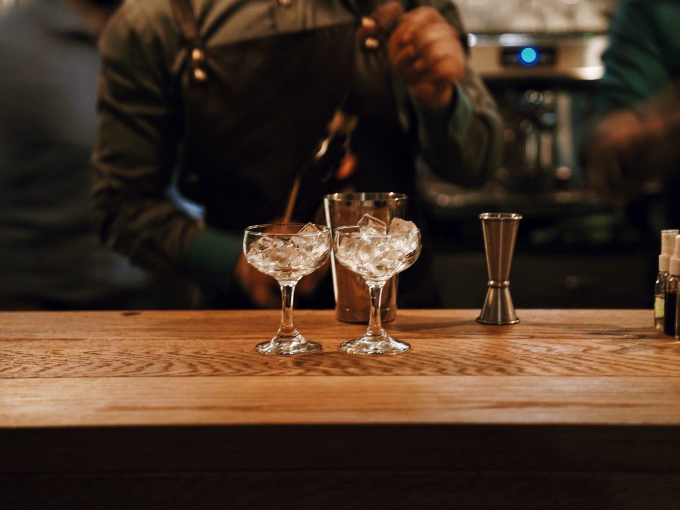 Boutique Hotels table wine person indoor glasses Drink wooden distilled beverage drinking Bar