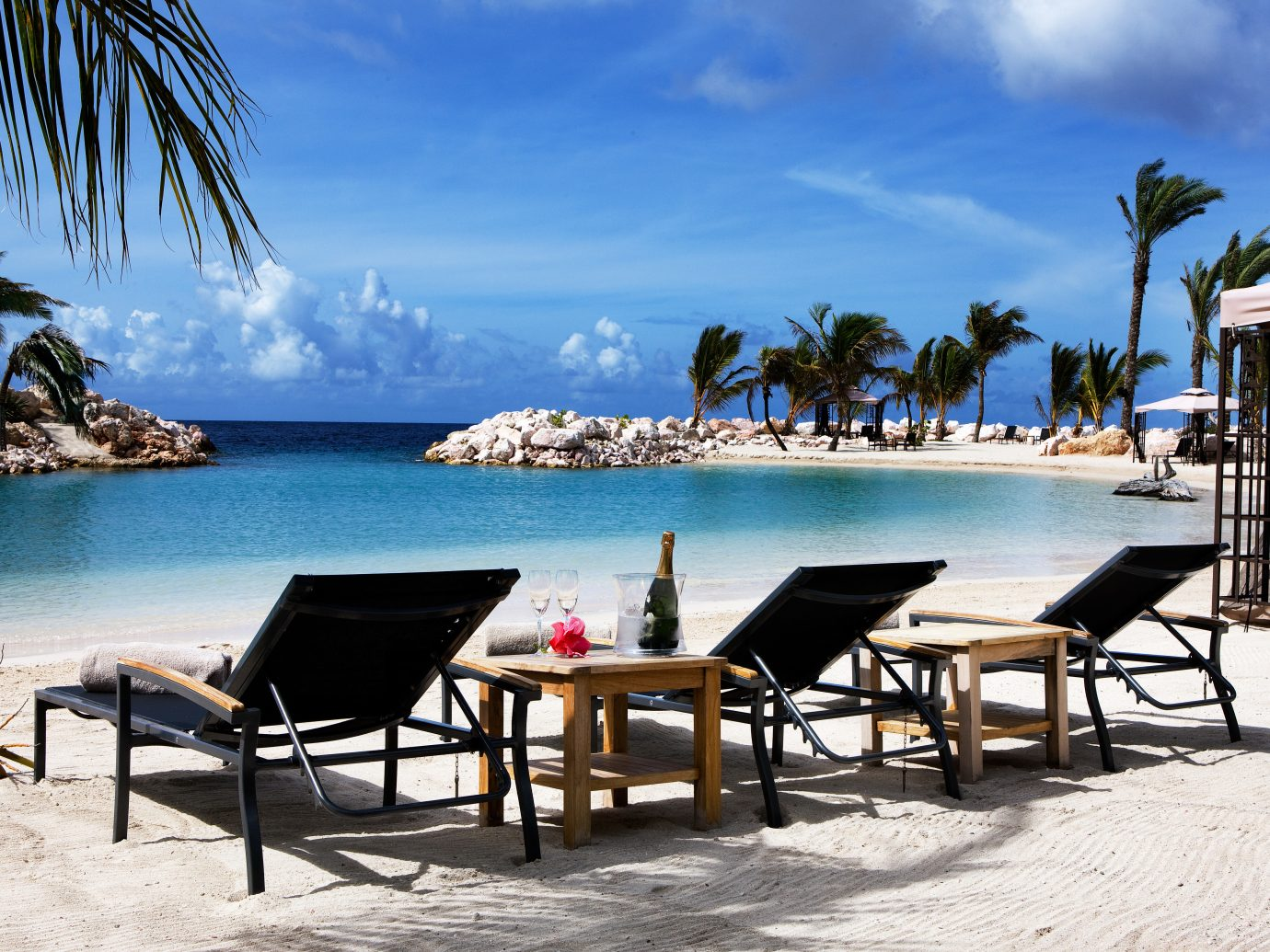 Boutique Hotels Living Lounge Luxury Modern Pool Romantic Getaways Romantic Hotels Tropical sky outdoor water tree umbrella chair Beach leisure vacation Resort Sea Ocean caribbean estate shore Coast bay arecales palm lined sandy day