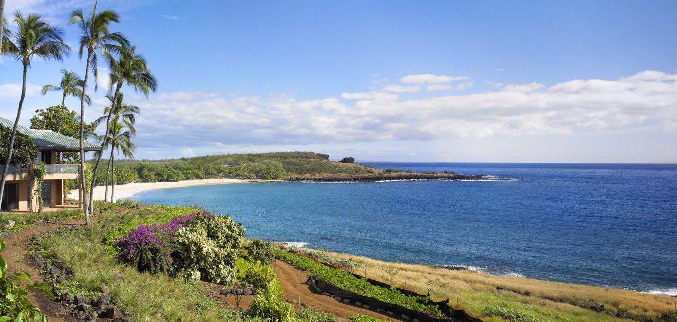 Hotels Trip Ideas sky outdoor water grass Nature property Coast shore Sea bay Beach Ocean Resort estate cove cape panorama terrain