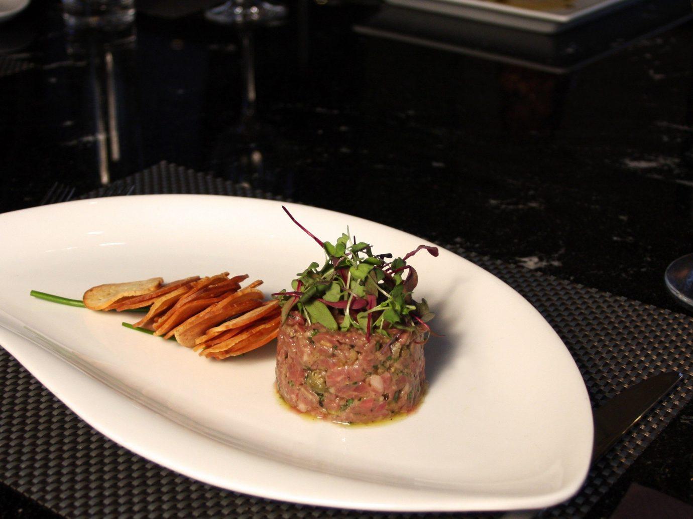 Travel Tips plate table food indoor meal dish cuisine brunch white steak venison meat beef tenderloin dinner piece de resistance