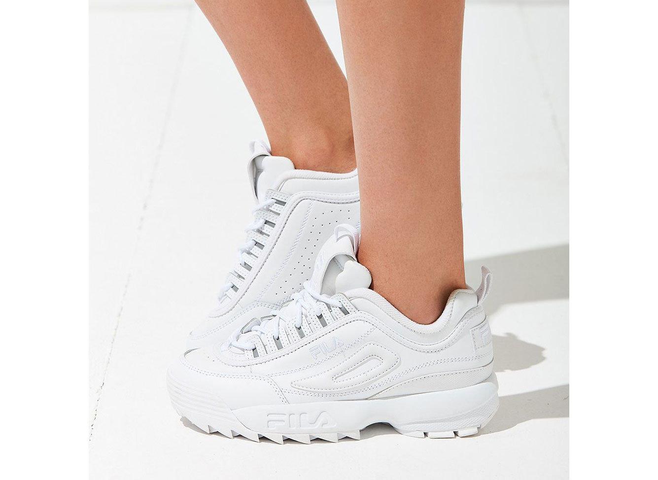 Celebs Style + Design Travel Shop footwear person shoe white sneakers clothing walking shoe sportswear outdoor shoe human leg product design product feet