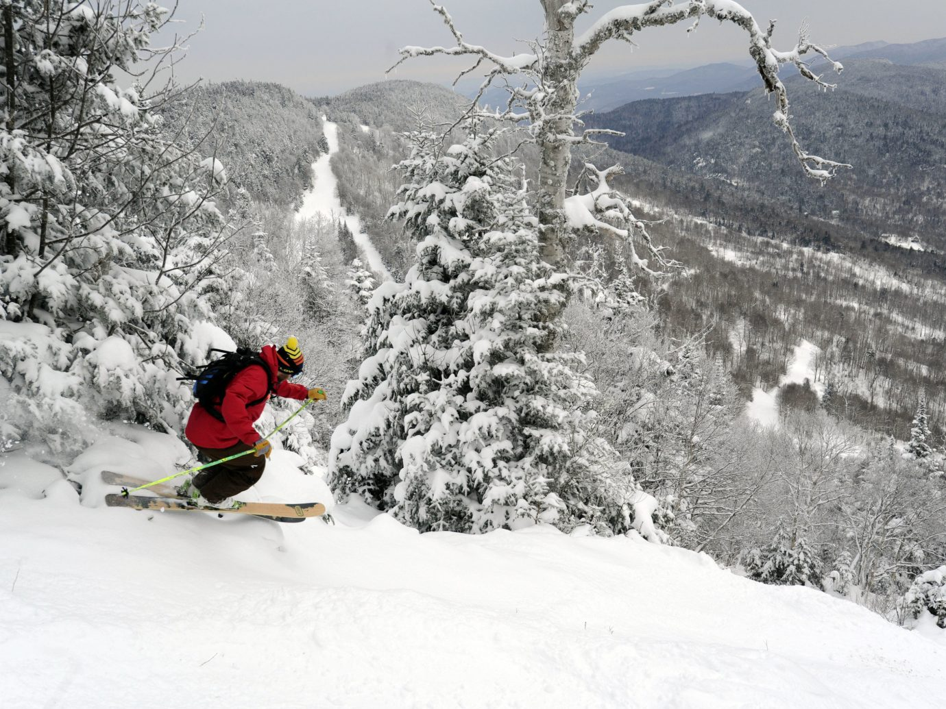 alpine skiing East Coast USA Jetsetter Guides Trip Ideas outdoor snow tree sky snowmobile mountain skiing person slope transport hill Winter geological phenomenon weather covered footwear Ski ski equipment winter sport piste sports extreme sport vehicle sports equipment freeride snowboard ski mountaineering mountain range ski touring day hillside