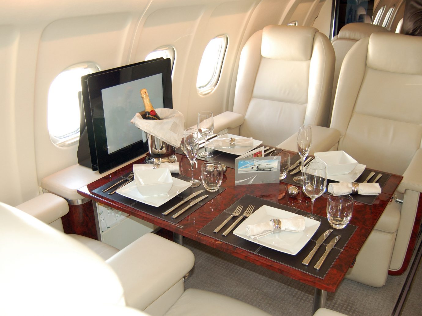 Flights Travel Tips indoor floor vehicle room Boat Cabin airline yacht Living passenger ship luxury yacht luxury vehicle interior design seat furniture