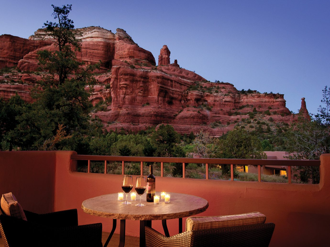 Hotels Jetsetter Guides Luxury Travel Trip Ideas Weekend Getaways sky Nature landmark Architecture wall mountain tourist attraction landscape rock red national park home tree canyon evening house tourism estate roof