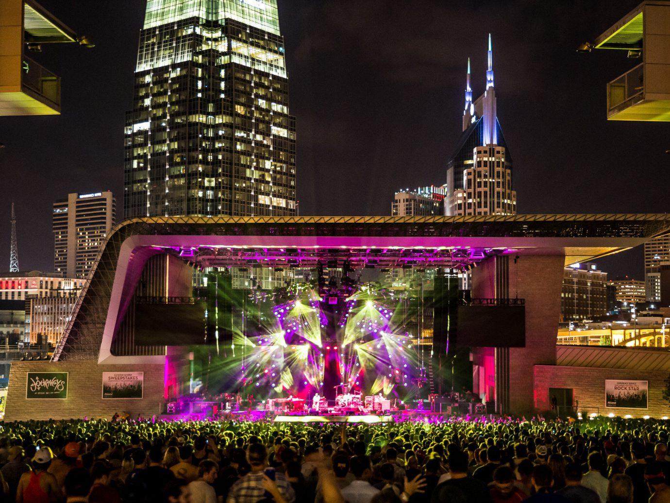 Offbeat crowd metropolis night City Downtown cityscape