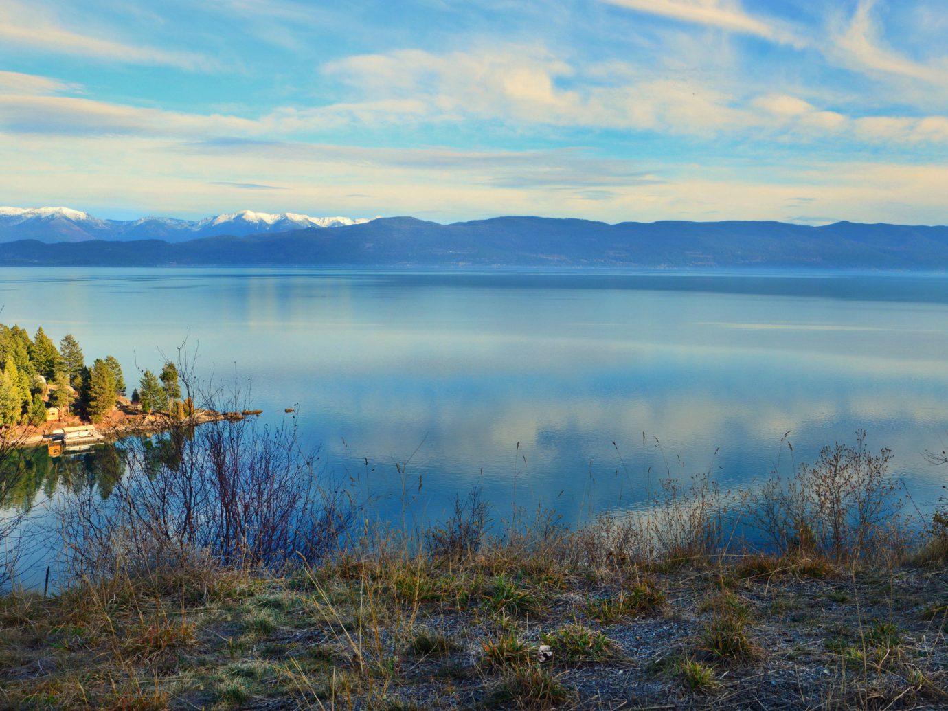 Lakes + Rivers Outdoors + Adventure Trip Ideas outdoor grass sky water Nature habitat reflection Lake wilderness atmospheric phenomenon body of water natural environment loch cloud mountain horizon morning pond dawn sunrise reservoir landscape overlooking wetland Sea meadow marsh dusk autumn hillside land lush