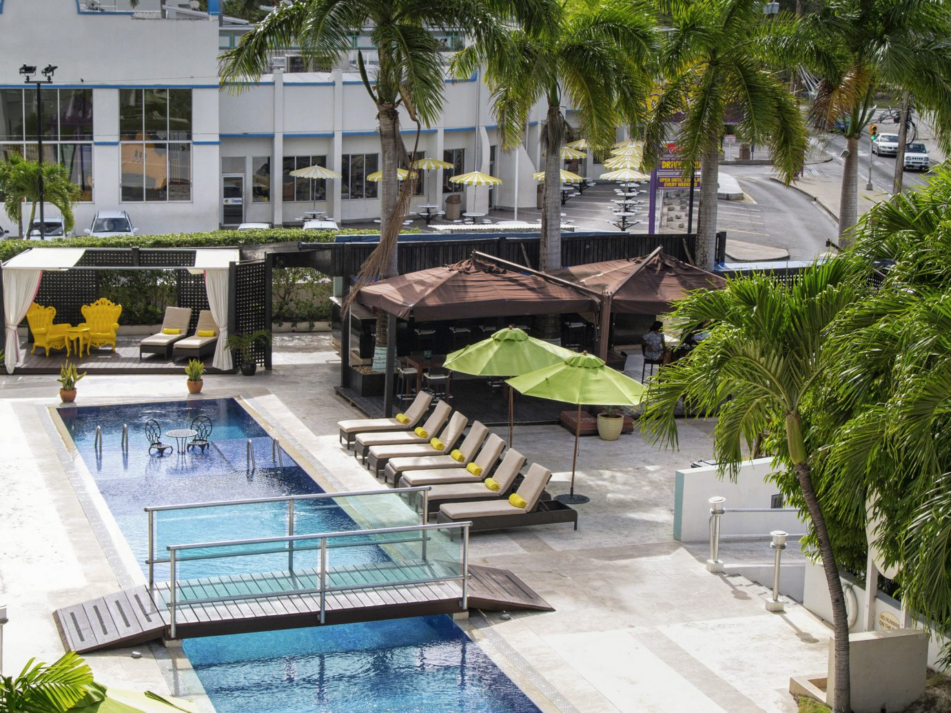 Hotels tree outdoor leisure swimming pool Resort estate vacation walkway condominium residential area waterway dock marina