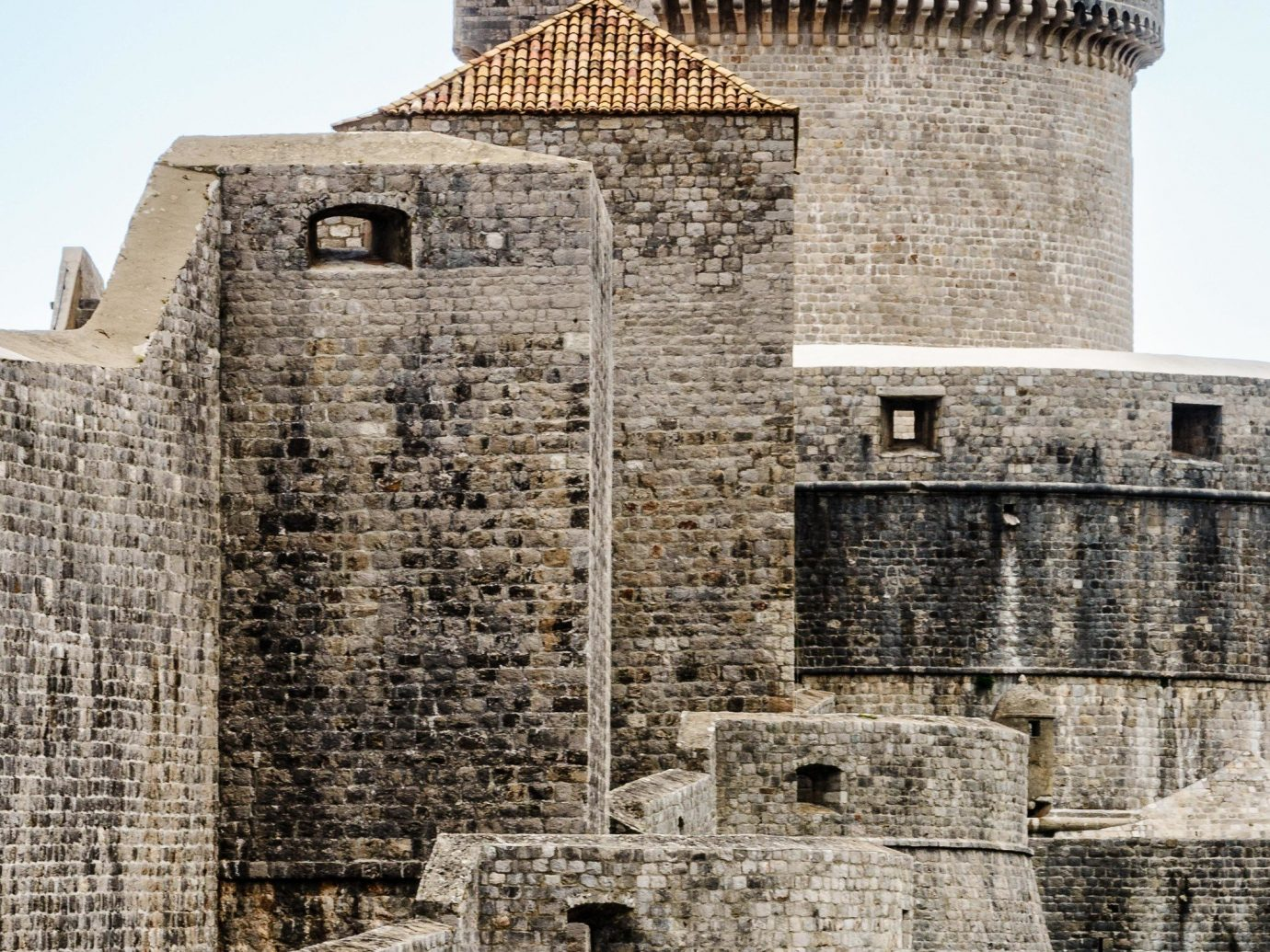 Offbeat building outdoor historic site fortification castle wall ancient history history archaeological site medieval architecture Ruins sky château middle ages stone tower facade turret tours structure