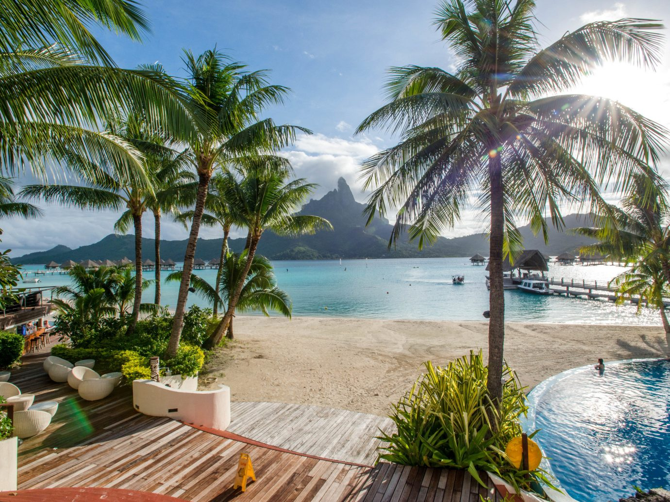 Hotels Trip Ideas tree outdoor palm sky water Beach Resort swimming pool leisure property caribbean vacation Pool plant arecales tropics palm family estate real estate Sea Lagoon bay lined shade Garden sandy shore