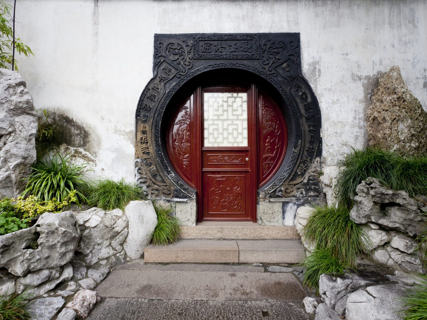 Offbeat outdoor building rock stone ground wall Architecture house arch ancient history Ruins monastery chapel temple door Courtyard window Garden shrine concrete cement