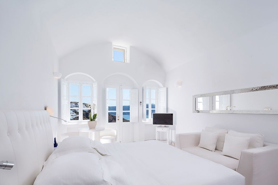 Greece Hotels Luxury Travel Santorini indoor wall bed room property white interior design home scene Suite real estate ceiling Bedroom hotel product design estate daylighting interior designer window house apartment pillow comfort bedclothes decorated