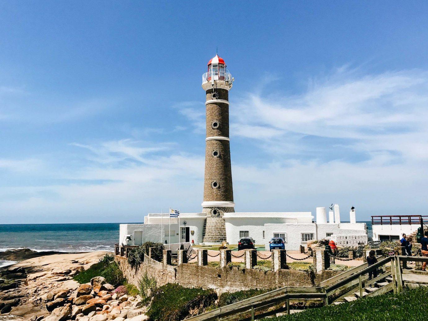 Beach Romantic Getaways south america Trip Ideas Uruguay lighthouse tower sky Sea Coast promontory beacon shore daytime cloud cape