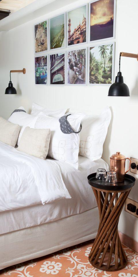 Hotels indoor wall sofa bed floor room living room interior design furniture hardwood wood home white pillow bed sheet Bedroom textile flooring several