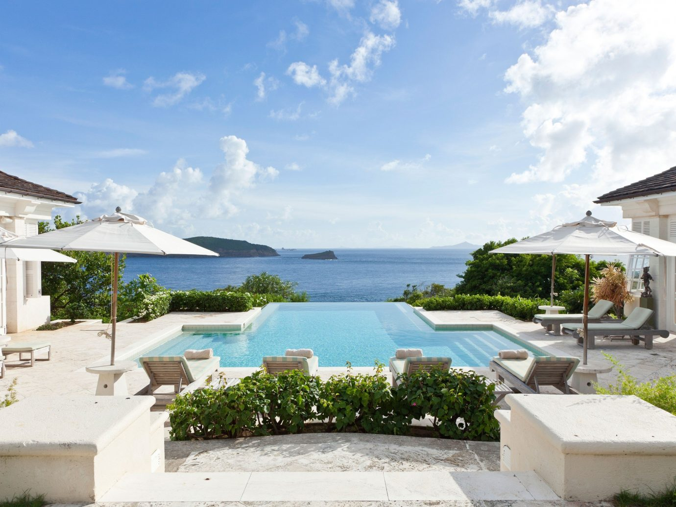 Luxury Travel Trip Ideas sky outdoor house property swimming pool estate Villa Resort vacation home real estate residential area mansion cottage condominium stone sign