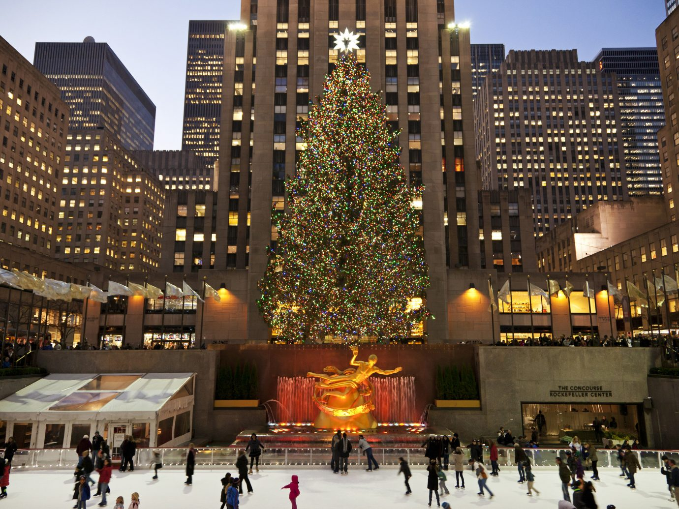 Trip Ideas outdoor building rink sky metropolitan area City landmark night human settlement metropolis people plaza Downtown evening cityscape shopping mall ice rink town square