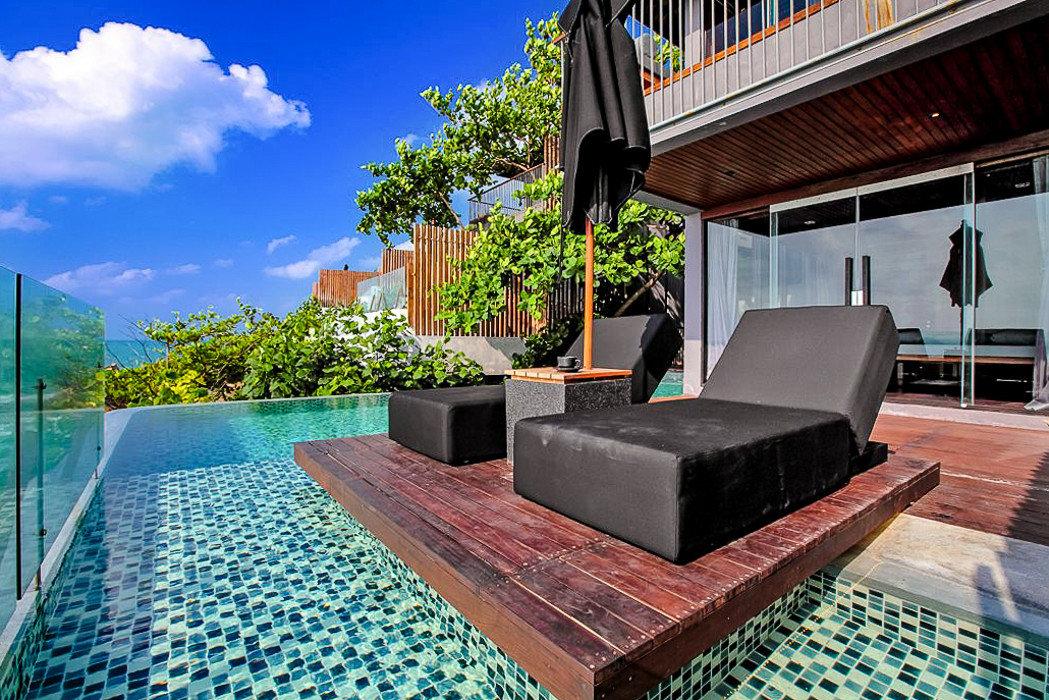 Hotels ground outdoor property swimming pool water building real estate estate leisure Resort condominium Villa house stone