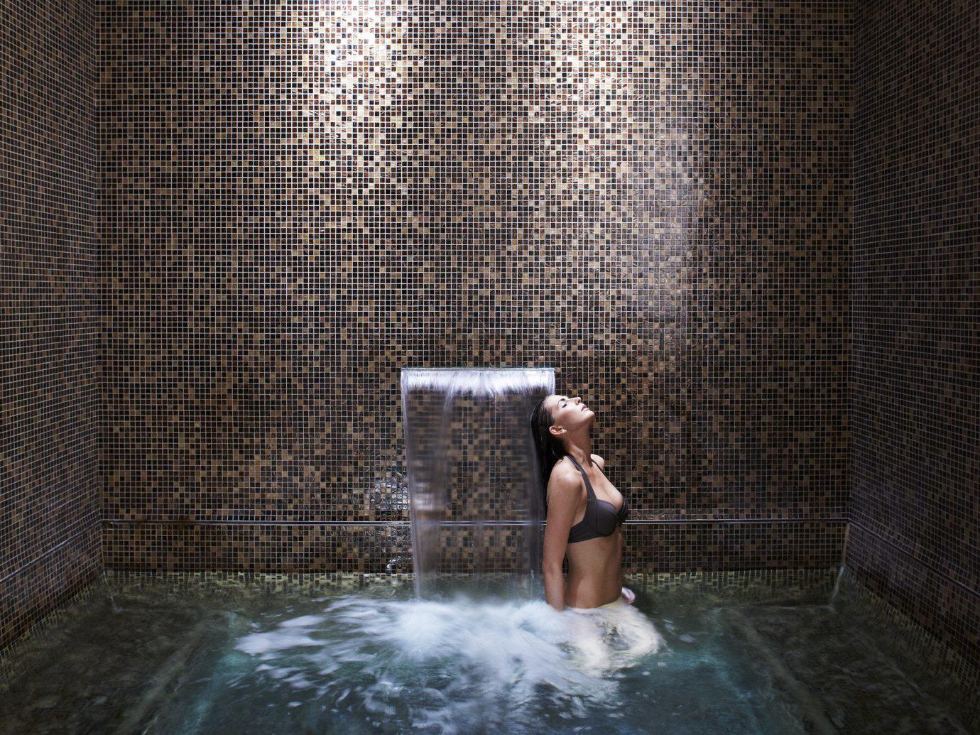 Health + Wellness Spa Retreats Trip Ideas image light swimming pool interior design water feature