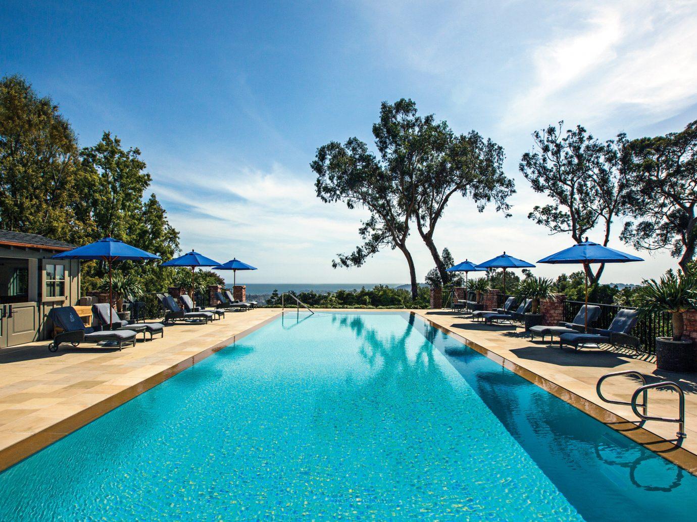 Hotels Play Pool Resort Trip Ideas sky outdoor tree swimming pool leisure property vacation estate blue resort town Sea real estate Villa bay caribbean shore swimming