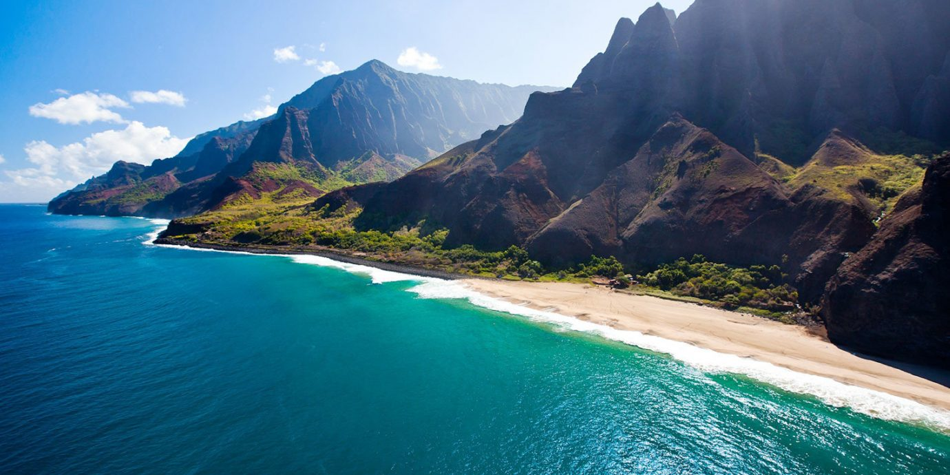 Beach Hotels Mountains Ocean Romance Trip Ideas mountain water outdoor Nature sky geographical feature landform Coast Sea body of water Lake vacation bay cliff fjord cape terrain mountain range islet surrounded Island hillside