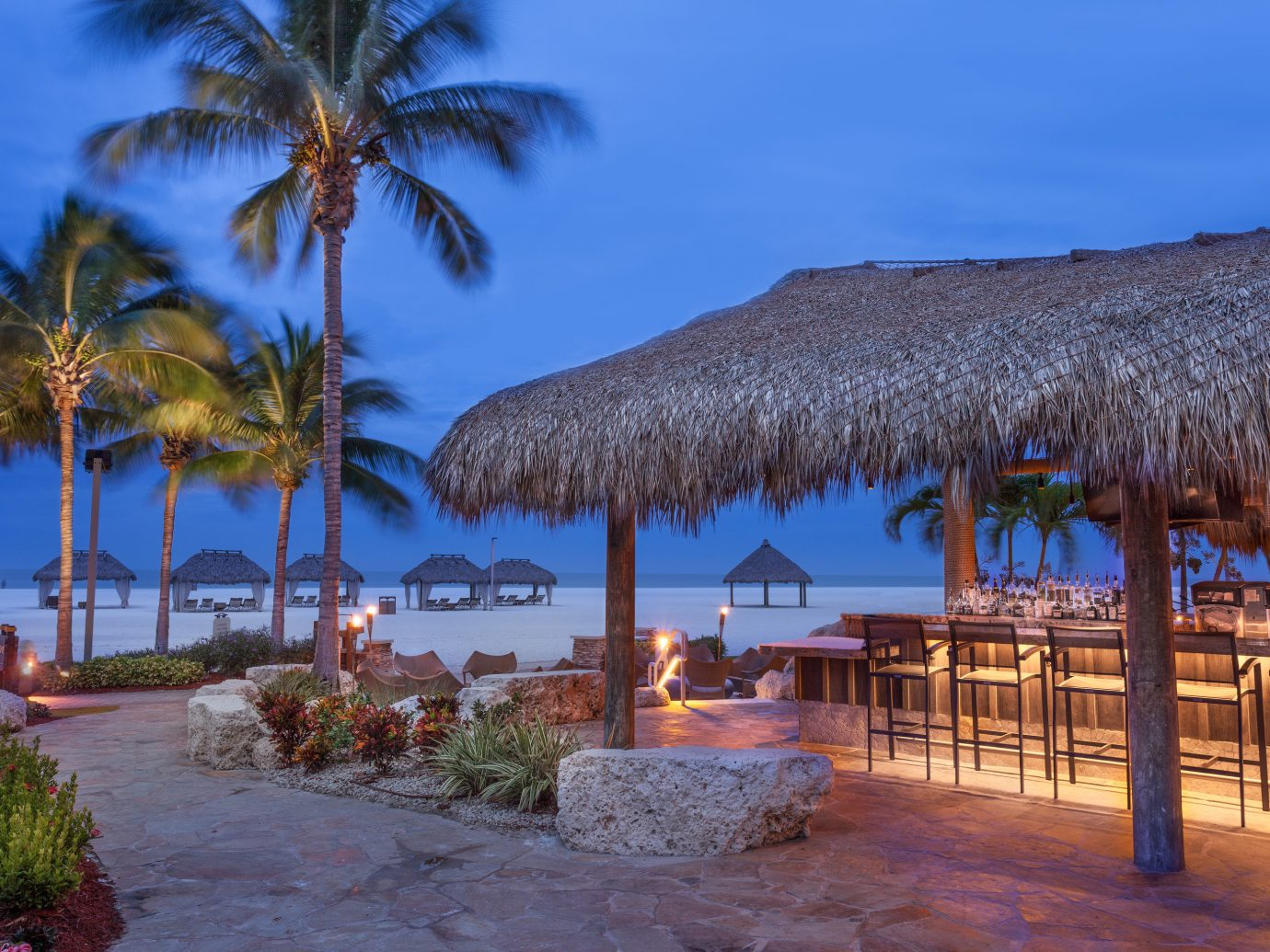Hotels sky outdoor tree water Beach palm Sea Ocean Resort vacation arecales estate shore Coast plant evening bay palm family Pool tropics Lagoon sandy lined