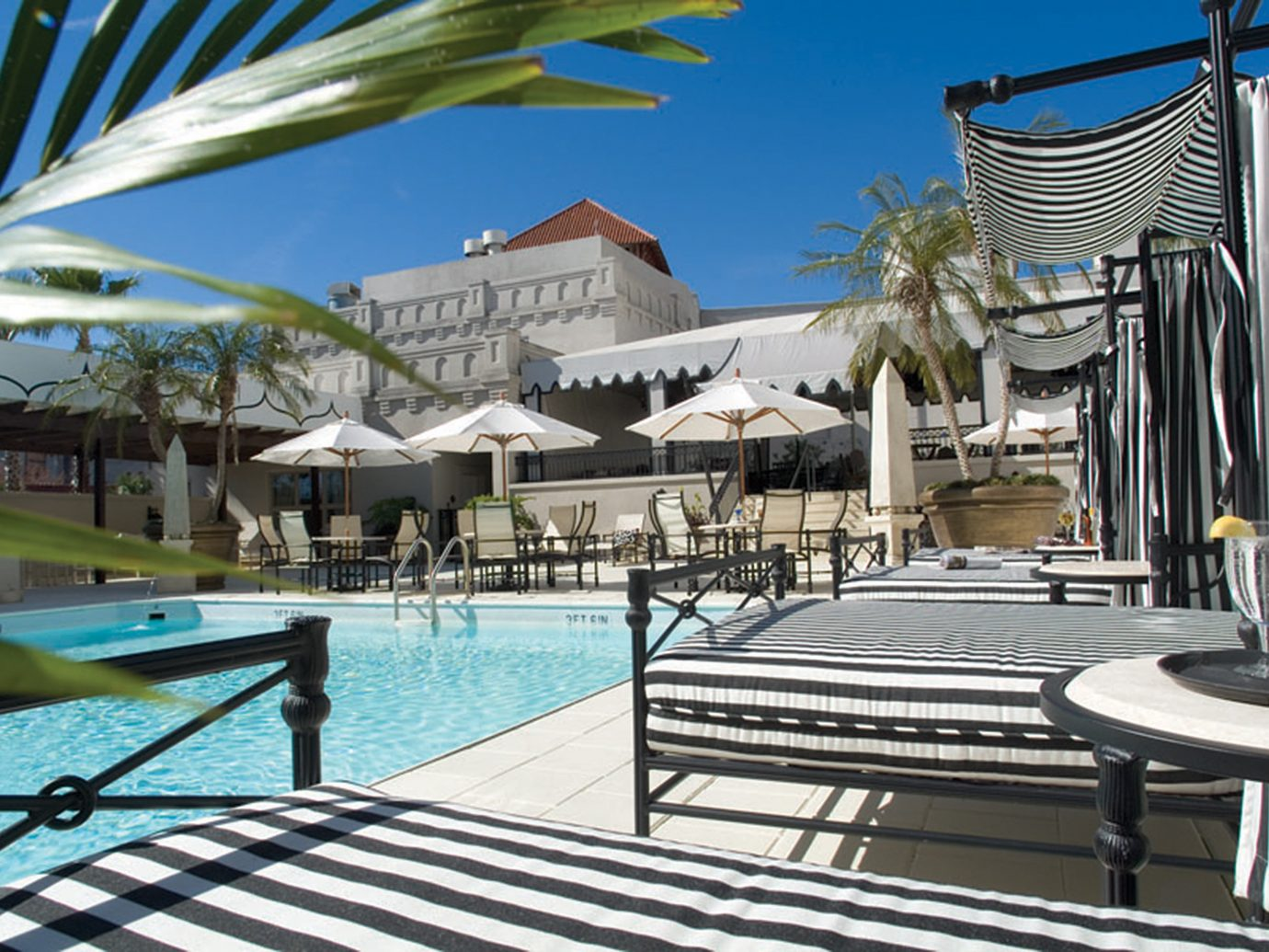 Deck Lounge Patio Pool Trip Ideas ground leisure chair property Resort swimming pool estate vacation condominium Villa caribbean real estate mansion