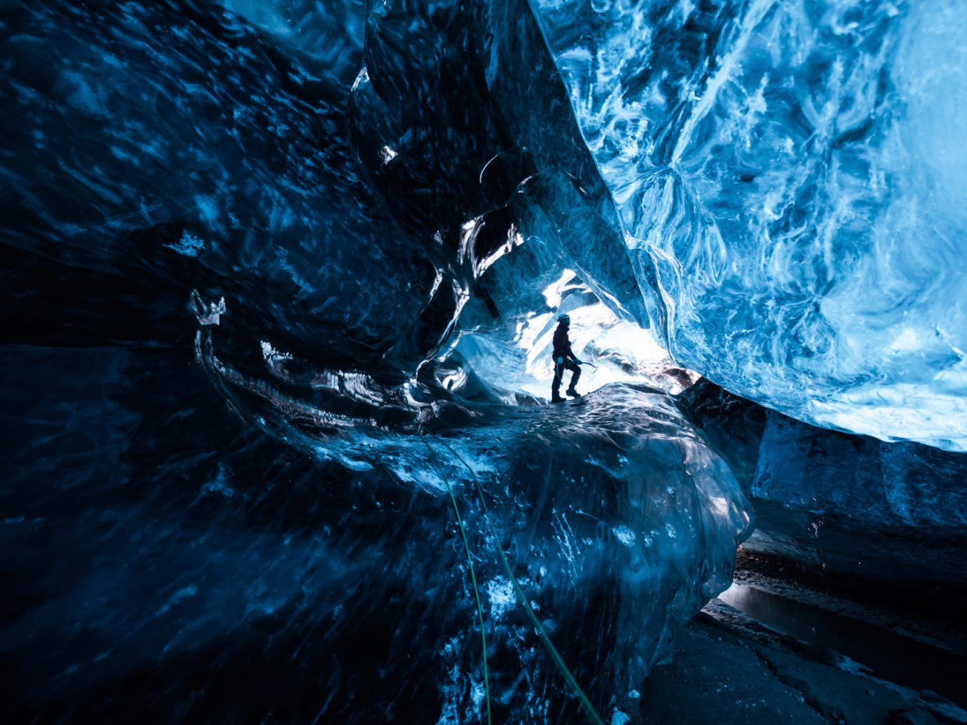 Iceland Outdoors + Adventure Road Trips blue ice cave landform geographical feature cave ice extreme sport screenshot glacial landform computer wallpaper