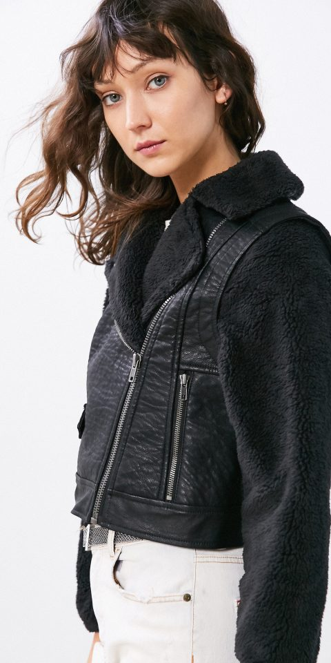 Style + Design person clothing leather denim outerwear jacket sleeve photo shoot textile fashion model fur collar zipper material posing dressed