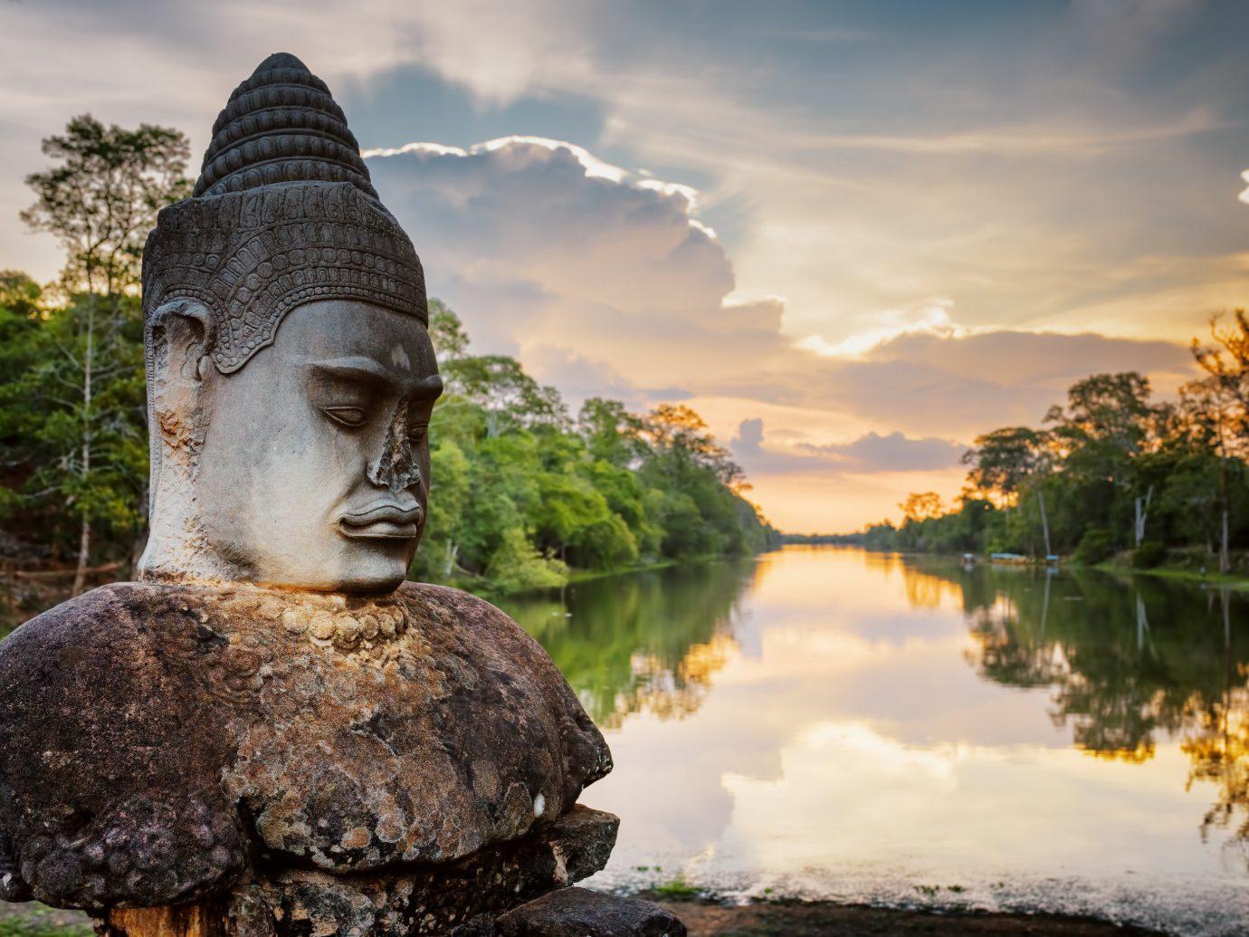 Budget Trip Ideas outdoor Nature tree reflection statue rock monument morning art sunlight temple autumn gautama buddha