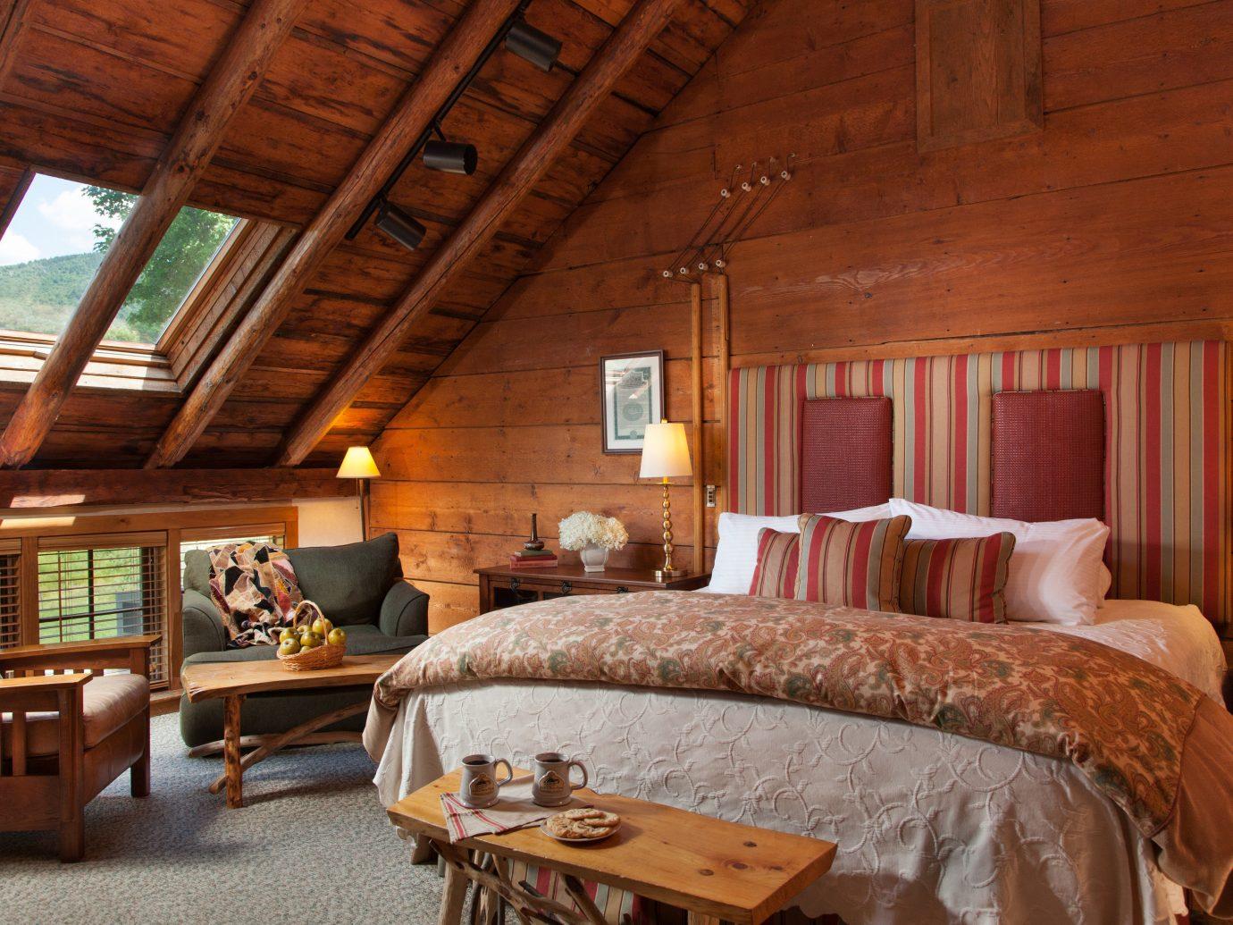 Jetsetter Guides indoor room floor bed property ceiling estate log cabin cottage farmhouse living room home interior design hotel real estate Bedroom Villa Suite Resort wood furniture