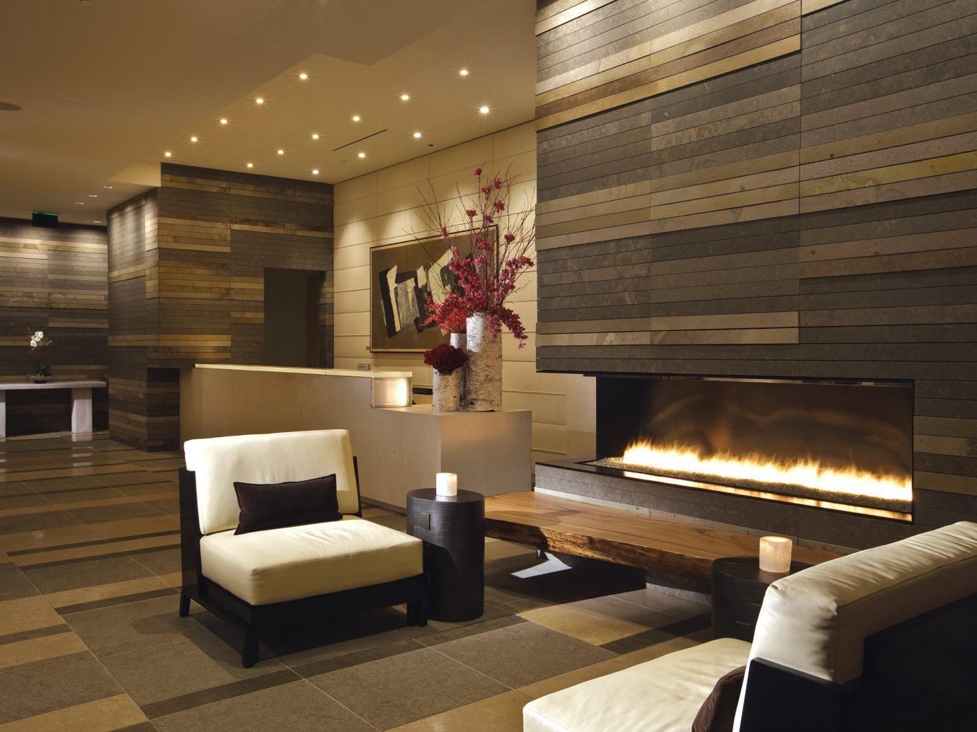 Elegant Fireplace Hotels Living Lounge Modern indoor floor room ceiling Lobby living room interior design estate lighting Design home wood furniture window covering