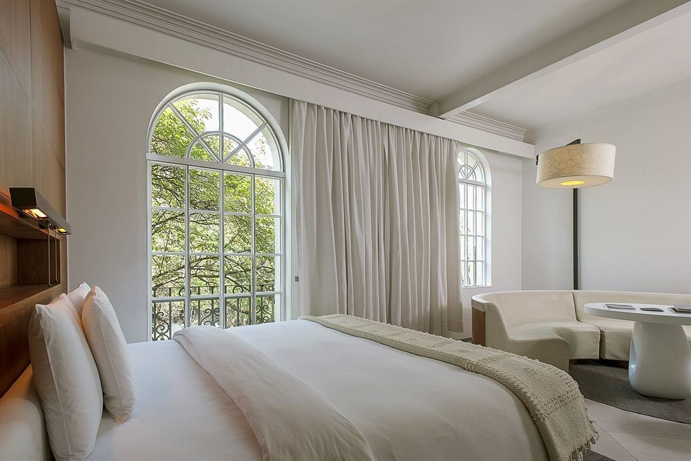 Hotels indoor bed wall room sofa window hotel floor ceiling Bedroom property interior design Suite estate home real estate pillow living room cottage furniture window covering apartment decorated