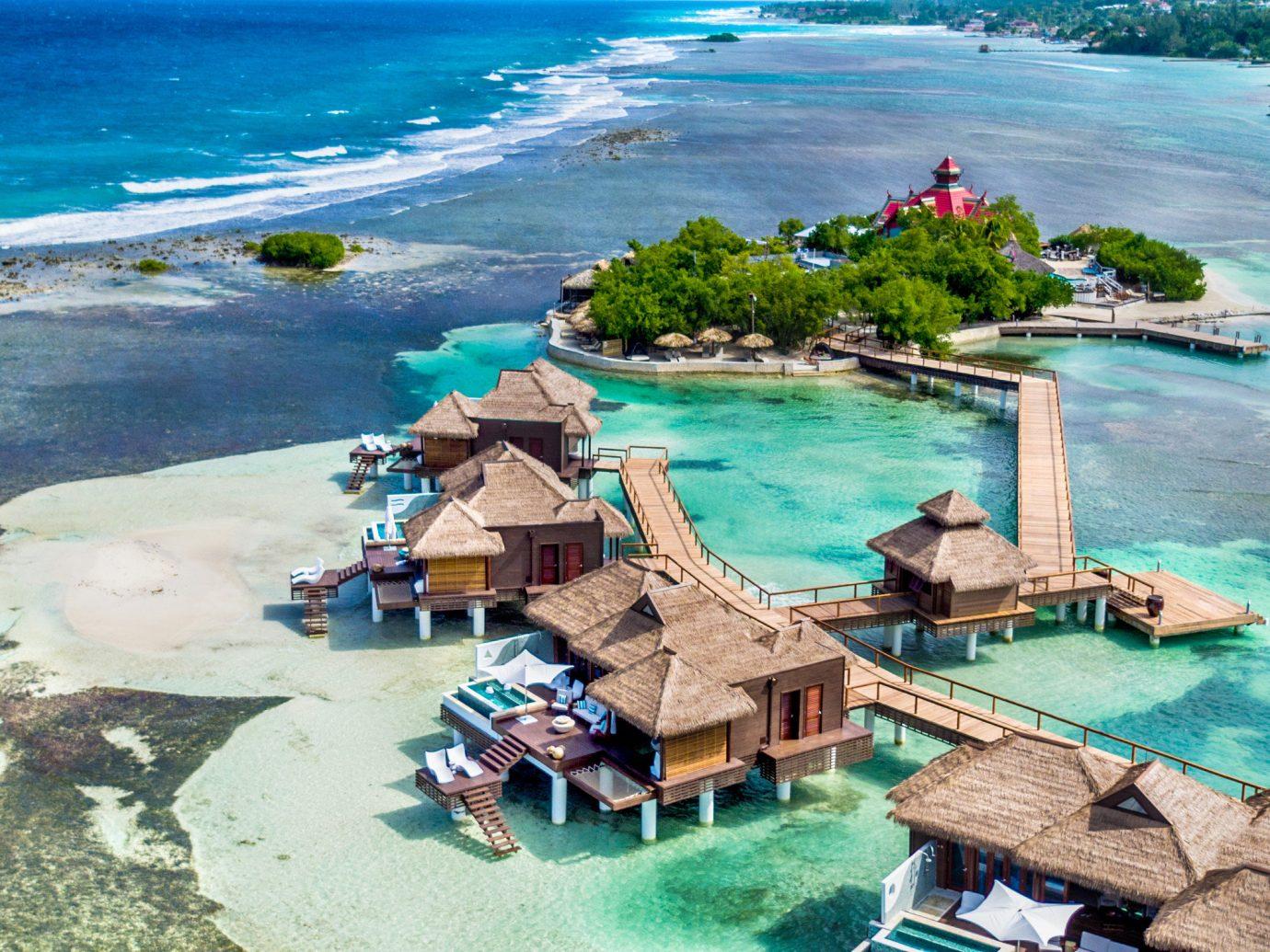 All-Inclusive Resorts Hotels water Sea outdoor Coast Nature vacation Ocean caribbean Beach bay Resort Island islet screenshot Lagoon terrain cape cove Water park shore