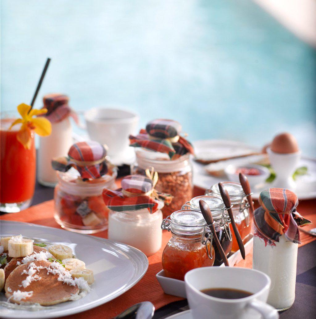 Beachfront Dining Drink Eat Honeymoon Hotels Luxury Romantic Wellness table plate food cup coffee meal dish lunch breakfast brunch restaurant dinner sense
